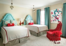 The girls' queen-size beds feature headboards covered in sensible faux suede by Osborne & Little. The fabric is repeated on the room's curtains, which are edged in Samuel and Sons red pom-pom trim. The contemporary painting was the handiwork of an orangutan at Zoo Atlanta.