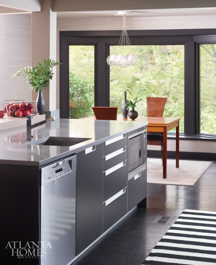"""""""We customized our Poggenpohl collection cabinetry to suit the client's request for bold appliances and dark colors."""" –John Coulter"""