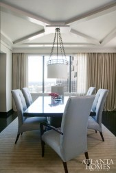 The dining table and chairs are by Bolier. The light fixture is by Thomas Pheasant for Baker.