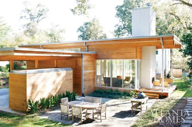Ben Park and Allison Loudermilk's 4,000-square-foot Decatur home was built from scratch using simple materials with minimalist applications. The couple's desire was to create a facade that melded with the character of the neighborhood, satisfying their penchant for something modern. The residential design that architect William Carpenter and his firm Lightroom delivered features a traditional front facade and rear modern structure-a harmonious compromise between the two.