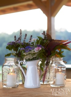 Mason jars and simple pitchers held candles and flowers grown in the gardens of White Oak Pastures.