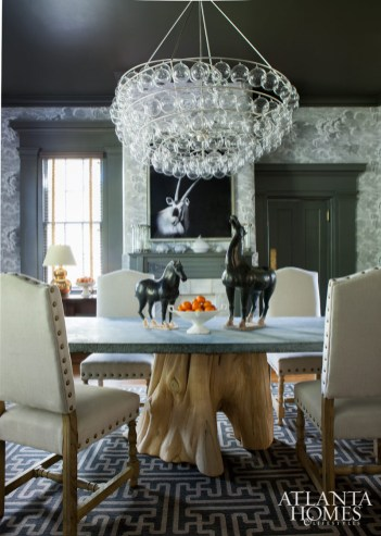 A blown-glass bubble chandelier presides over a custom-designed zinc-and-pecky cypress dining table.