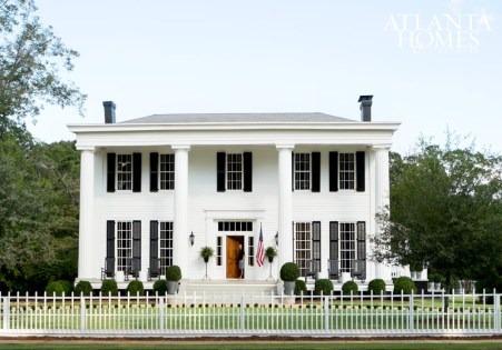 Stanton surrounded Honeymoon's 5,000-square-foot, four-columned main house with a period-appropriate fence of precise design and height.