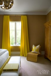 The sunny guest room on the home's lower level remains bright, thanks to bursts of yellow that pop against textured walls, and a polished bathroom that positively shines.