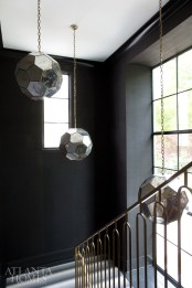 Circular glass pendants make a dramatic statement in the stairwell and can even be admired from the exterior windows.