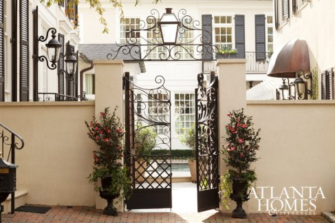 """""""The exterior gates, doors, and iron work are some of my favorite elements of the townhouse,"""" says architect Jim Strickland of the Peachtree City development designed by his firm."""
