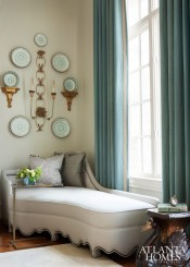 In the formal living area, aqua window panels frame the cream chaise, which is upholstered in a party-friendly fabric. The floor-to-ceiling window treatments play on the room's varying tones of blue.