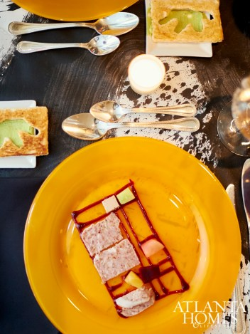 A Mondrian-esque terrine pops against Boomershine's handpainted tablecloths.