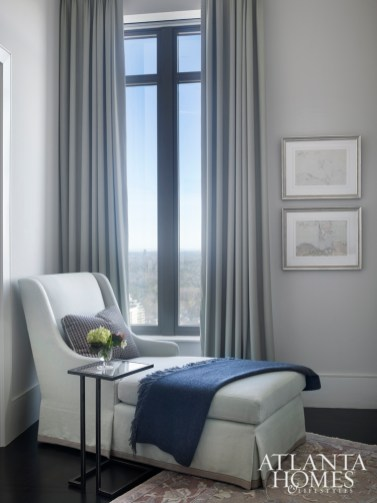 A chaise provides the ideal spot for respite while overlooking the Atlanta skyline. Maps of Hong Kong from the homeowners' collection provide visual interest.