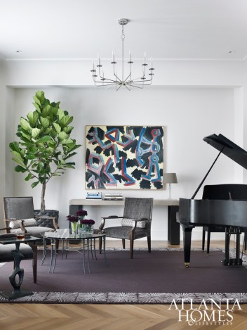 Armchairs by Artistic Frame and an Avrett coffee table balance a painting by A. R. Penck and a sleek grand piano in the formal living room.