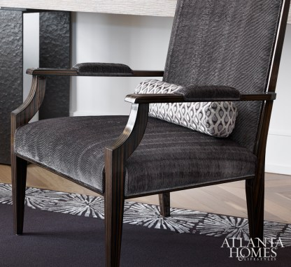 Armchairs by Artistic Frame maintain the home's subdued color palette of white, gray and blue.