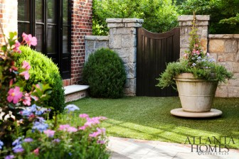 The outdoor landscape is as carefully edited as its studied interiors by designer Joel Kelly. Courtyard design by David Bennett of Bennett Design & Landscape.