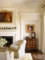 Architectural moldings and niches provide fitting vignettes for the homeowners' collection of antiques and decorative arts.