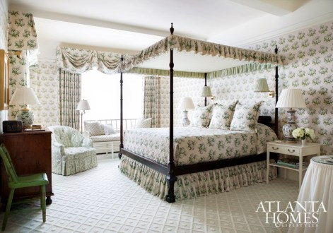 The four-poster bed from The New Traditionalists is encapsulated in the Colefax & Fowler chintz used throughout the master bedroom. The clients' antique chest rests on Stark carpet.