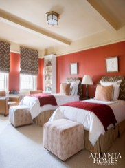 Crisp linens in a children's bedroom balance bold reds and browns.