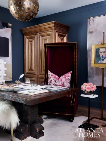 Atmospheric abstract art pays tribute to Mitchell's grandmother's pensive nature, while plush textures hint at her sense of style. A handsome carved desk showcases a treasured collection of magnifying glasses.