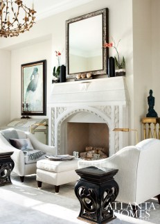 An inviting seating area next to Francois & Co.'s ornate, grey-polished Victoria stone mantle.