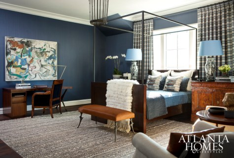 Vivid blues and burnished bronzes create an intimate feeling in the upstairs guest suite designer by Karen Ferguson.