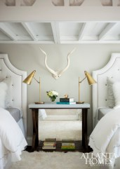 Cheerful white bedding and an alpaca rug soften the space, as do tufted headboards.