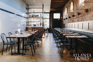 Designed by Square Feet Studio, the restaurant is housed in a turn-of-the-century brick building.