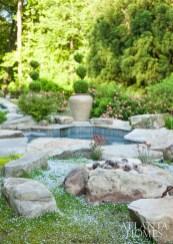 Excavated granite boulders from the yard act as sculptural pieces by the swimming pool.