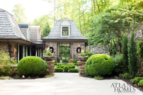 A once crumbling Sandy Springs fixer-upper now percolates with country-manor charms, like manicured gardens touting sculptural boxwoods.