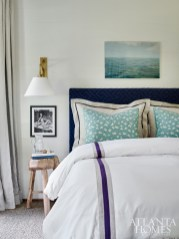 The guest room's color scheme evokes the currents of water. The powder room, painted Wythe Blue by Benjamin Moore, pulls from the greens and blues outside.