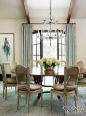 A round table from Ainsworth-Noah serves feels anything but formal thanks to cane-back chairs and French doors.