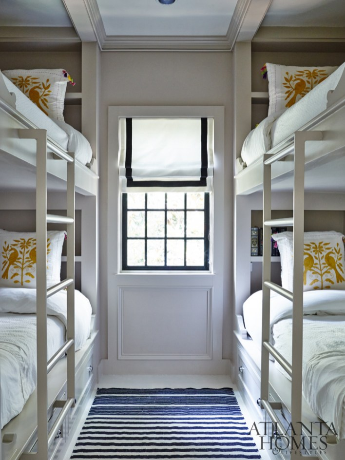 Dixon designed a compact bunk room that boasts a quad of sleeping spots complete with Otomi toss pillows.