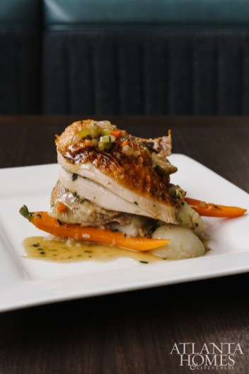 Herb-roasted chicken with heirloom carrots and whipped Yukon potatoes.