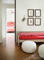 Duffy takes a more vibrant approach in the daughter's bedroom, which features an adjoining seating area. Here, she can lounge with friends on an antique daybed and poufs from Serena & Lily.
