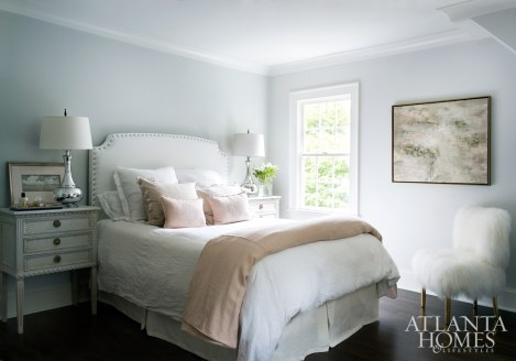 Blush linens from Atlanta Premier Upholstery, plus an antique French settee from Huff Harrington Home, make for a dreamy bedroom for daughter Lilly.