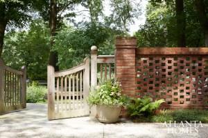 A custom wood gate reveals the riverfront renovation.