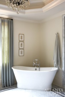 A skirted tub by Sunrise Specialty is placed in the corner of the master bath so as not to take up additional real estate in the room.