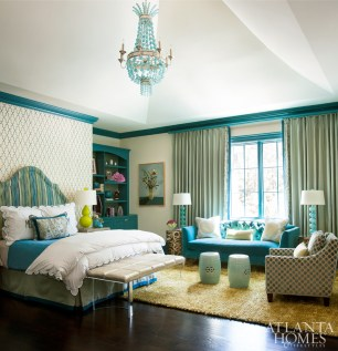 In the teenage daughter's bedroom, Phillip Jeffries wallpaper in Moroccan Trellis accents the room's high-gloss trim in Calypso Blue by Benjamin Moore. A custom headboard by R. Hopkins & Company is covered in Romanesque Velvet Stripe in Sky by Schumacher.