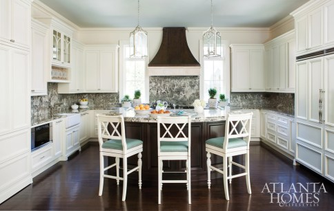 Ivory Beach granite covers the backsplash and countertops of this eat-in kitchen.