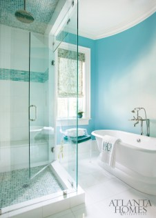 A glass mosaic pattern by Traditions in Tile pairs perfectly with turquoise in the daughter's bathroom.