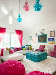 Accessible through a swinging bookcase from each of the girls' bedrooms, this hangout is outfitted with hot-pink and turquoise chandeliers by Cyan Design, Hallman Furniture chairs covered in pink leopard from Lewis & Sheron Textiles, and a custom tufted ottoman.