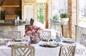 Overlooking the varied hues of a lush golf course, the rear patio is ready for entertaining thanks to weather-resistant furnishings from Restoration Hardware and retractable screens.