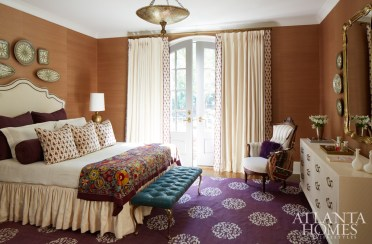 Hand-thrown plates from Erika Reade and a reupholstered Tony Duquette bench infuse the daughter's bedroom with style. Wallcovering, Phillip Jeffries.