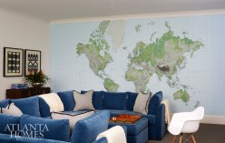 The children's rec room features the Dr. Pitt Sectional from Mitchell Gold + Bob Williams. The map is custom color and scale to fit room, from London, serves as a fun conversation piece with kids of places that they've traveled.
