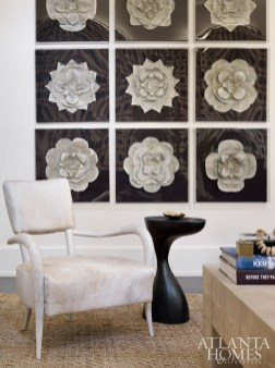 Framed metal sculptures by Tommy Mitchell make for a stunning focal point.