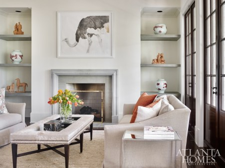 Webb came across the striking watercolor ostrich painting by Heather Lancaster via Spalding Nix Fine Art's Instagram account. Its soft coloring was a perfect match for the room's plaster and terra-cotta sculptures that are displayed on the new niche shelves. The sofas and pillows are from Bungalow Classic.