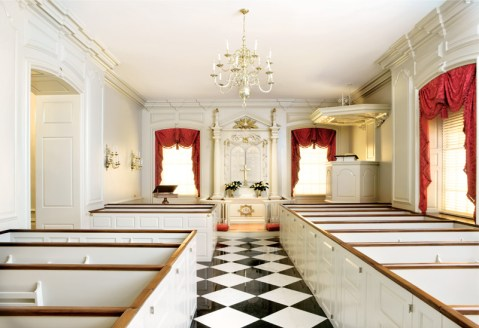 Box pews were dismantled and removed from the chapel to be stripped and repainted with an oil-based finish. Kneelers, worse for the wear after 50 years of use, were reupholstered up to antimicrobial standards and hand-nailed with brass tacks, like the originals. The black-and-white marble floors, long subjected to cleaning with linoleum wax, were stripped and restored.