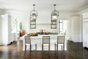 """""""We wanted everything to look like it might have been original,"""" says designer Nancy Duffey, who selected classic bell-jar lanterns and a brass faucet for the kitchen, both of which are in keeping with the age of the house. Platter, B.D. Jeffries. Chairs, Holland & Company. --"""
