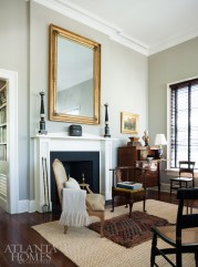 A large gilt mirror complies graciously with the scale of the formal living room at Redland, while a neutral color palette lends itself to period architecture and furnishings, including candlebra and an antique box from Parc Monceau. Pillow and throw, Dixon Rye.