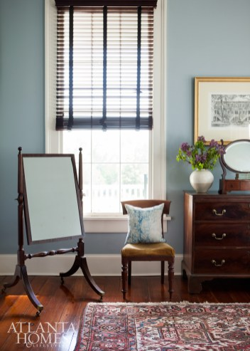 A Cheval mirror, classical side chair and chest anchor the gracious windows. Vase and pillow, Dixon Rye.