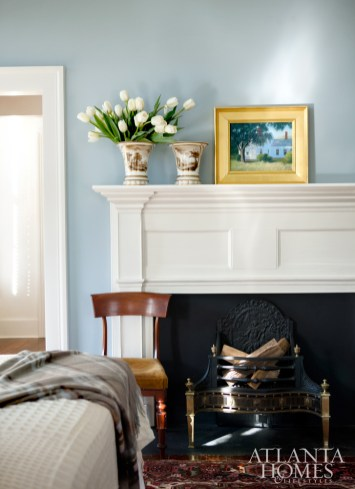 The 19th-century master bedroom mantel is from nearby Columbus, Ga. Vases, Parc Monceau.
