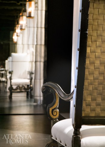 An antique mirrored wall at the end of the hallway reflects the strong, rhythmic gestures McAlpine and Ferrier have taken care to create for the employees of their architecture-and-design firm, newly relocated to ADAC.