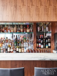 """""""The bar was by far the most dramatic change,"""" notes Klaskala. Indeed, a new signature white marble tops a walnut base to highlight an array of premium and small batch liquors, while no-reservation seating lends itself to casual dining."""